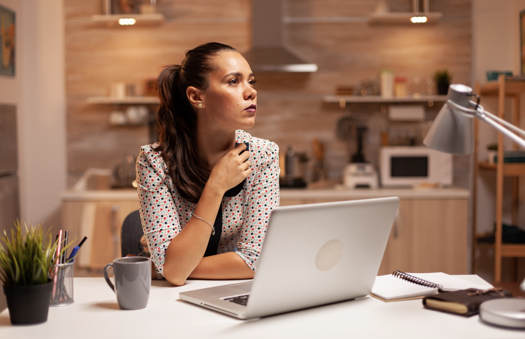 Woman thinking about moving forward with the work life coach